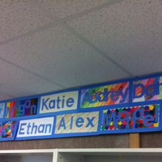 Beginning of the school year activity. Have the kids draw a design on their white piece of paper (I didn't tell then what it would be for, and when they were finished they were so impressed!), then back them with colored paper, I used blue for this one. The. Dye-cut their names out of the same color.  Very cool looking and great way to personalize the room in the beginning of the year.