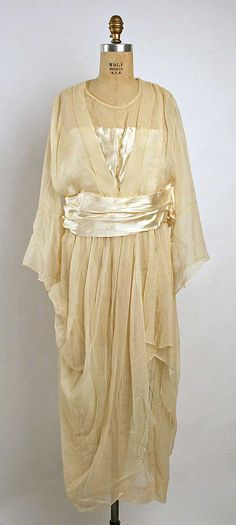The choice of styles in bridal gowns from the 1920s era is considerable. Through the 1910s up to the early 1920s, oriental styles were popular – mimicking the Japanese geisha look amongst others. Here's a lovely example from the Met Museum from 1919.