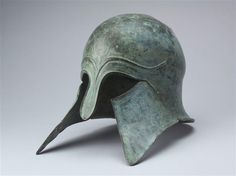 Corinthian Greek helmet, 6th C BCE, from Olympia. Now in Louvre.