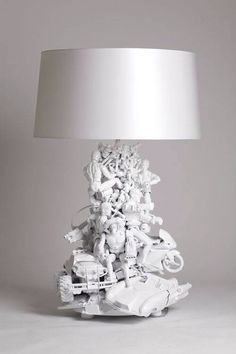Now I know what to do with all these toys laying around my house. DIY lamp. Recycled old toys lamp.
