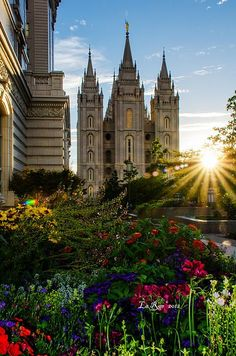 Salt Lake Temple Sunburst!  SLC, Utah LDS   (Mormon) Temple rises above the flowers. Tourists by the millions visit this   temple every year. Families are sealed together for time and all eternity in   these beautiful buildings. The landscaping is breathtaking and the temple can be   viewed from many angles and with many flowers or trees to adorn the   architecture, filling the soul with a sense of peace as you walk these hallowed   grounds.