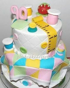 Sneak peek - custom quilt / sewing theme cake for a 90th birthday celebration. 100% edible. Includes: spools of thread, pin cushion, measure tape, buttons, quilt squares and the lower tier is covered with a quilt pattern. Quilting,  sewing cake idea, 90th birthday. #poshcakedesigns.com #birmingham al