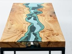 Home geography: Sublime salvaged wood furniture, overlaid with rivers of glass.  I love these.  ($$$$)