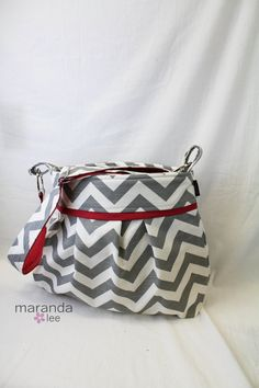 Stella Chevron Diaper Bag - Large Messenger Bag - Gray Chevron with Red- with Elastic Pockets Adjustable Comfort Strap Stroller Attachment. $88.00, via Etsy.