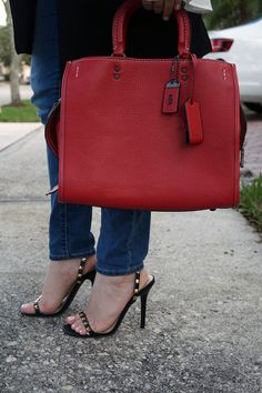 fe1c6c22125e Black heels with the right touch of color. Red Rogue Coach Bag by Ana  Cristina