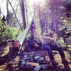 camping / tent / fire / coffee / woods / axe