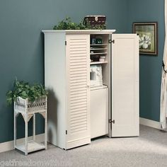 beautiful sewing cabinet. Hides your sewing machine and supplies away in a pretty cabinet.
