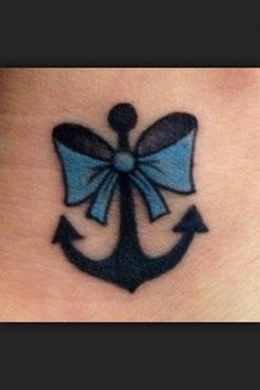 anchor with (red and white polka dot) bow tattoo