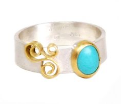 Turquoise Dot Ring by Natasha Jewelry  |  $375.00  (inspiration: Mongolian skies) With the pale blue color of Persian turquoise, this ring has a pop of color, a playful asymmetry and can be easily stacked with other rings. This color hold particular attraction as it resembles the vast blue sky over the plains of Central Asia. A 22K gold bezel and an 18K gold filigree accent compliment the silver band, which comes in white or black silver.