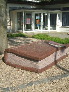 A sculpture of a book outside a library in Berlin.