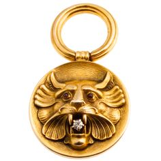 1900s victorian 14ky gold lion with ruby eyes and diamond mouth pendant