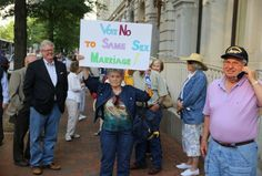 Marriage equality supporters and opponents gather outside the federal courthouse in Richmond, Va., on Tuesday, May 13, 2014.