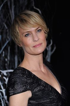 Robin Wright's new short cut features bangs that are integrated with the short haircut: very face-framing and flattering.More about bangs over 40:Best Bangs Over 40 - Julianne MooreDos and Don'ts of Bangs Over 4013 Ways to Wear Bangs Over 50