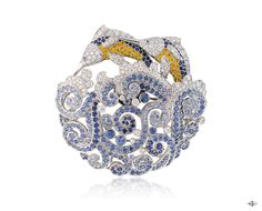 -Marlins clip, Les Voyages Extraordinaires™collection-  White gold, round diamonds, blue and yellow sapphires