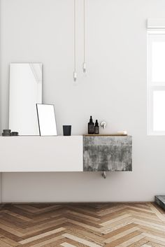Bathroom with herringbone wood floor and concrete sink. Passeig de Gràcia by Katty Schiebeck.
