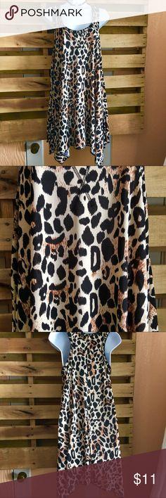 Sweet Juliet leopard dress/tunic sz 1X Cute handkerchief hemline leopard print sleeveless razorback dress in 1X by Sweet Juliet. Adorable. Soft and flowy-looks fantastic with leggings. Has side pockets. Super comfortable. Sweet Juliet Dresses Asymmetrical
