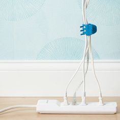Decrease power cord clutter by clinching them together with a small hair clip.