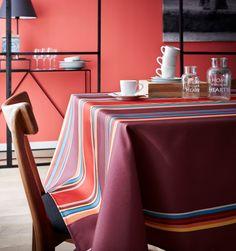 Créez une nouvelle décoration de table avec la nappe DUNES figue en 100% polyester, de fabrication française. D'inspiration linge basque, vous donnerez un air estival à votre table. L'effet lin apportera un style authentique et tendance à la fois. Très facile d'entretien, les tâches ne seront plus un problème pour vous ! #nappe #madeinfrance Decoration, Ottoman, Chair, Polyester, Furniture, Authentique, Home Decor, Inspiration, Style