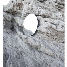 #photograph of the #contrast between the #naturallandscape of the #mountains and a #roundmirror creating an #abstract #illusion #art #artphotography