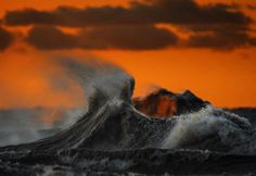 """Dave Sandford, who is best known for his sports photography, spent October to December capturing images of the waves of Lake Erie. Each photo shows an eerie immensity and power that can be found on the lake. The series is called """"Liquid Mountains"""", which is an accurate description for the waves that come in the surprisingly shallow lake. For more of his work, check out his website."""