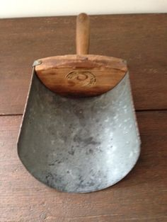 """GALVANIZED TIN GRAIN SCOOP  This Antique Galvanized Tin Grain Scoop is sturdy enough to use for household tasks, but pretty enough to display! It looks great with our measures or trencher.  12.5""""X6.5""""X4"""""""