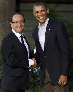 U.S. President Barack Obama (R) greets French President Francois Hollande as he arrives at the G8 Summit at Camp David, Maryland May 18, 2012.