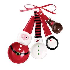 Holiday Measuring Spoon Set | The Holiday Measuring Spoon Set is both decorative and functional adding a touch of holiday cheer to your kitchen • Includes 1 tbsp. (Santa), 1 tsp. (Snowman), ½ tsp. (Penguin), ¼ tsp. (Reindeer) • Ceramic ~ Avon Rep Beth Bailey ~ Avon eStore LipstickShoesAndMore.com