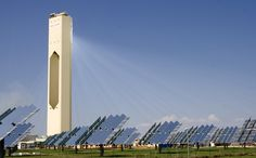 """Planta Solar 10, Seville, Spain. """"The 11 megawatt (MW) solar power tower produces electricity with 624 large movable mirrors called heliostats. [...] Each of the mirrors has a surface measuring 120 m² (1,292 square feet) that concentrates the sun's rays to the top of a 115 metre (377 ft) high, 40-storey tower where a solar receiver and a steam turbine are located. The turbine drives a generator, producing electricity."""""""