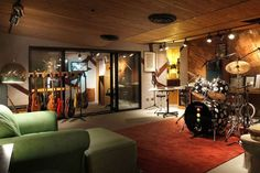 Basement man cave music room with guitars and drums
