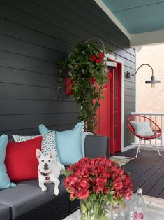 A young and playful exterior with lots of color, a welcoming porch with lush hanging baskets and new landscaping makes the front yard come to life and creates an urban home with major curb appeal. Red Door House, House With Porch, Exterior Paint Colors For House, Exterior Colors, Outside House Paint Colors, Outside House Decor, Concrete Front Steps, Feng Shui, Front Porch Seating