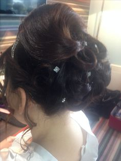Smooth swirl and looped updo