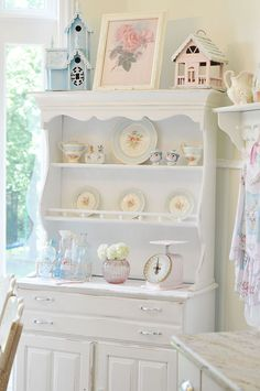 Shabby cottage hutch - I love the birdhouses on top with the picture.