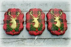 Sweet Butter: Christmas. Reindeer silhouette in gold against a Lumberjack Plaid background.
