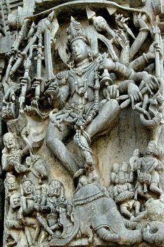 Hoysala sculpture of Shiva dancing on a demon elephant representing illusion.  Chennakesava Vishnu Temple, Belur, Karnataka, India, 1117AD.