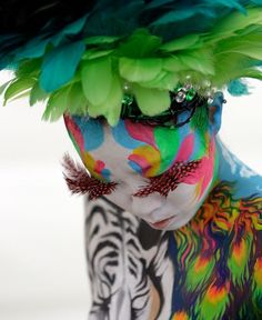 A model participates in the 2010 Daegu International Bodypainting Festival on August 2010 in Daegu, South Korea. The festival is the largest in the field of body painting and introduces the art form to thousands of visitors each year. We Are The World, People Of The World, Plastic Bottle Flowers, Plastic Bottles, Face Art, Pretty Flowers, Face And Body, Daegu, Body Art