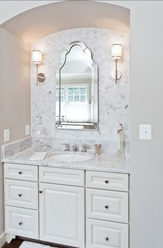 Powder Bath with Hex Marble Backsplash and White Cabinets via Homebunch