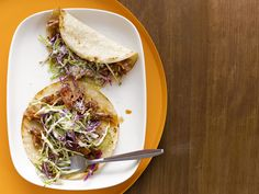 A Photo-galary of Taco Recipes for a Mexican Fiesta. *** Wine-Braised Pork Tacos : Melissa's tacos use budget-friendly pork and bacon, cooked in a Dutch oven and then served on a soft tortilla with a crunchy fennel slaw. via Food Network Mexican Fiesta Food, Mexican Dishes, Mexican Food Recipes, Ethnic Recipes, Mexican Tacos, Mexican Meals, Food Network Recipes, Food Processor Recipes, Cooking Recipes