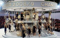 Chanel for fall 2008 included a giant, white and whimsical carousel embellished with oversize Chanel bags, bows and pearls.