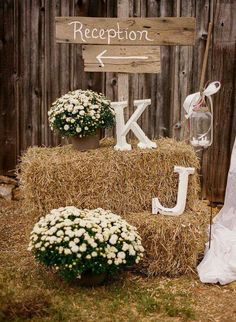 So sweet a few hay or straw bales and s sign for directions.