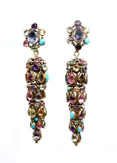 Pair of 19th century multi coloured gem set chandelier pendant earrings, c.1820,  the oval cluster tops suspending a gem set dome and three graduated circlets below, each hung with a fringe of pear shaped stones, close set in gold, the stones including amongst others turquoise, garnet and amethyst