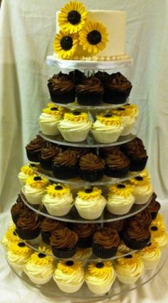 Here's a new twist on a wedding cake....a cupcake tower in the shape of a wedding cake!  This is an easy way to serve your guests...no cake...