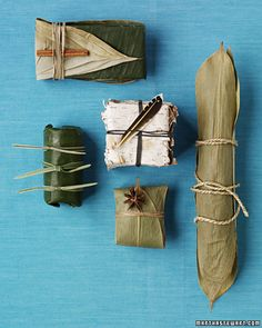 Eco Gift Wrap: Clockwise from top left: Banana leaf with cinnamon, bamboo leaves with hemp twine, bamboo leaves with star anise, banana leaves with reeds, birch bark with a feather. Christmas Gift Wrapping, Christmas Gifts, Bamboo Leaves, Plant Leaves, Santas Workshop, Wrapping Ideas, Wrapping Gifts, Furoshiki Wrapping, Wrap Gifts