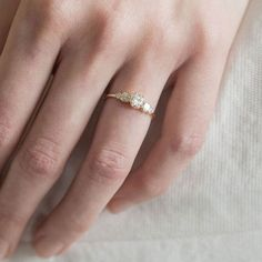 Our take on the five stone meet our new diamond Sonnet ring   Sonnet is limited edition featuring a half carat white diamond center and cushion cut diamond sides set in 14k gold