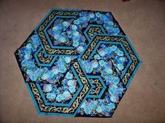 My Triangle Frenzy's made with 60 degree ruler - this looks like a fun project using a border print