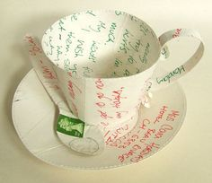Jennifer Collier cup and saucer   *Must now cover EVERYTHING in books*