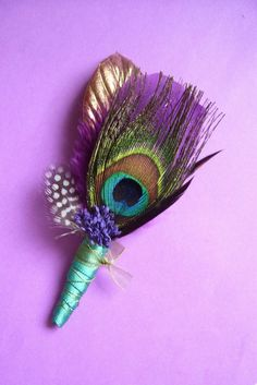 I love the idea of peacock feathers in the wedding, and it just so happens purple is my favorite color! #boutonniere, #peacock