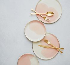COUNTRY Handmade in Israel. COLOR DETAIL Ivory white, blush pink and gold. DESCRIPTION Organic shaped, white limoges porcelain with a watercolor splash of blush pink. Genuine gold has been hand-painte Pink Plates, Small Plates, Pink Dinner Plates, Pottery Plates, Ceramic Plates, Crackpot Café, Organic Shapes, Kitchenware, Table Settings