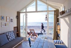 Sleep on the beach of the Dutch North Sea coast? Rent one of the new beach houses in Den Haag seaside resort Kijkduin! The luxurious street . Huge Houses, Beach Bungalows, Seaside Resort, Single Sofa, The Hague, Beach Cottages, Beach Houses, Design, Amsterdam