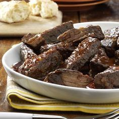 Slow-Cooked Short Ribs Recipe -Smothered in a mouthwatering barbecue sauce, these meaty ribs are a popular entree wherever I serve them. The recipe is great for a busy cook - after everything is combined, the slow cooker does all the work.—Pam Halfhill, Medina, Ohio