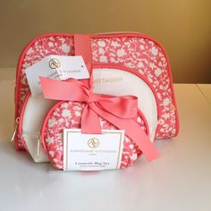 """Coral & Cream 3 Piece Cosmetics Set Store all your goodies in these adorable top zip closure cases. Keep your makeup and all those miscellaneous items, that some how always end up lost in the bottom of your purse, safe and organized  large case 9 1/2"""" L x 1 1/2"""" W x 6 1/2"""" H - Medium Case - 8"""" L x 1"""" W x 5""""H Small Case- 5 1/2"""" L x 1"""" W x 3.75"""" H Adrienne Vittadini Bags Cosmetic Bags & Cases"""